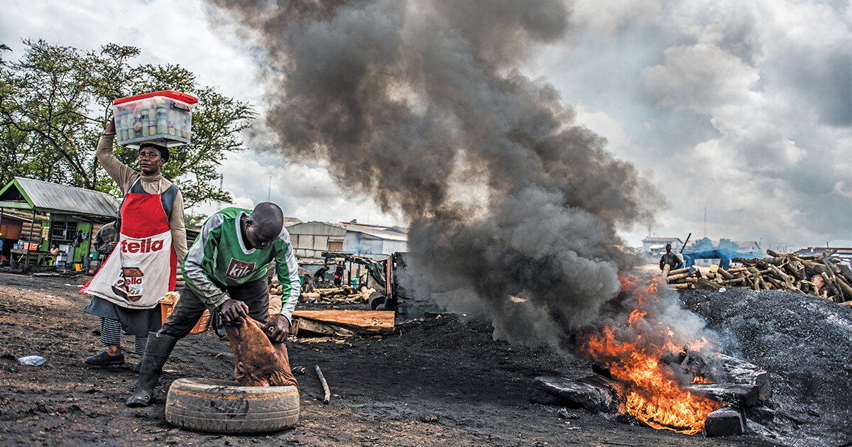 As liquefied petroleum gases have grown more expensive, Ghanaian companies have begun using tire fires to process meat for human consumption. (Rob G. Green and Michael O'Hara)